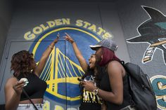"Even as the Golden State Warriors were thumping the Houston Rockets in Game 5 of the Western Conference finals, the city of Oakland was suffering a humiliating defeat.  [...] it was nearly shut out.  There was barely a mention of the word ""Oakland"" on the national telecast of the Warriors clinching their first spot in the NBA Finals in 40 years.  Nearly all the gauzy cutaway shots before the commercial breaks showed all the usual Oakland icons: the Golden Gate Bridge, the Transamerica Pyramid, cable cars and Alamo Square.  Oakland is sick of being largely invisible to the national TV audience, its only representation an occasional nighttime shot of Jack London Square that looks like, well, a dock at night.  Oakland is tired of being dismissed as the foster parent of a franchise that never took our name.  Visit Oakland, the city's tourism arm, felt the same fatigue at seeing Fisherman's Wharf shots during Warriors games.  [...] Kim Bardakian, its director of public relations, approached ESPN/ABC producers with suggested locations to shoot in Oakland.  [...] that hasn't stopped national broadcasters from invariably saying they're ""heading back to the San Francisco Bay Area.""  The team has always been a good draw, even attracting the league's ninth-highest attendance in the 2008-09 season with an abysmal 29-53 record and Ronny Turiaf — bless his leap-too-early, shot-blocking heart — seeing way too much floor time.    [...] that next Warriors diaspora begins, national media types seem more comfortable with an O-word Oaklanders don't need to hear: ""Oracle.""  An arena is not a city, and a few aerial shots of a concrete doughnut don't offer an honest portrayal of a real-life Oakland neighborhood.  Word leaked that then-owner Franklin Mieuli was pursuing a deal to play half the Warriors' games in Oakland, and the other half in San Diego, which had just lost its NBA team to Houston.  Coincidentally, the current Warriors ownership tries to put a happy regional face on the whole ""Golden State"" charade.  ""The team became the San Francisco Warriors after they relocated to the West Coast in 1962, and changed its name to the Golden State Warriors — symbolizing a team belonging to all of California, the Golden State — upon settling into a new home in Oakland in 1971,"" its website reads."