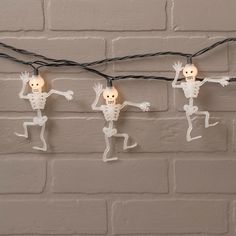 Haunt your friends and family on Halloween with our dancing skeleton string lights! Warm white lights illuminate 10 white skeletons, each 5 inches tall and spaced 10 inches apart.