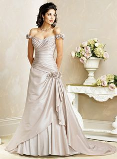 Colored wedding dress made of taffeta basically features A-line silhouette, off-the-shoulder neckline and corset closure. The bodice is asymmetrically wrapped to the side hip with bouquet accented.  Cascading ruffled drapes flows elegantly along petal skirt. Colors available shown in Color Options. Custom-to-measurement for any sizes.