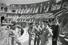 New Zealander soldiers on leave in Rome, Italy, with a guide at the Colosseum (July 3, 1944)