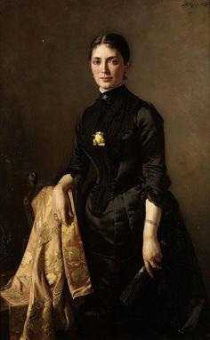 Carl Rudolph Sohn | Portrait of a lady, three-quarter length, standing beside a chair, holding a fan, 1889. German, 1845-1908