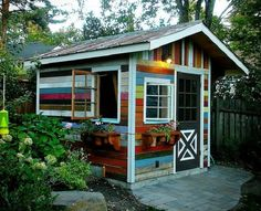 Shed made out of reclaimed and recycled wood.  A little paint gives the shed extra character. blog.urbanwoodgoods.com