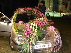 Wedding offers a mix of classic and contemporary wedding car decorations. Wedding Planner Games, Indian Wedding Planner, Wedding Hall Decorations, Flower Decorations, Free Wedding Catalogs, Wedding Gate, Indian Flowers, Photo Booth Backdrop, Wedding Crafts