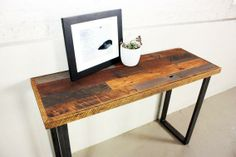 Reclaimed wood from a midwestern barn was made into this beautiful console table/desk. #reclaimed #recycled