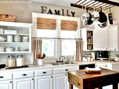 window treatments , open shelves, butcher block there is so much to love about this kitchen