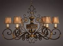 Oblong chandelier of gold leaf and antiqued finish. Features hand sewn silk shades with braided trim.