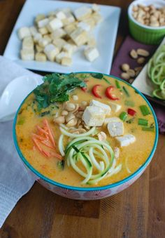 Thai Coconut Zoodle Soup ~ Skip take-out and make this vegetarian soup for a healthier version of your favorite Thai soup! The zucchini noodles lighten up this soup and pair well with the crispy tofu, fresh vegetables and Thai flavors like lemongrass and coconut milk.