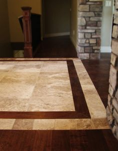 Eagle Ridge Floors To Go - Cedar City, UT, United States. Wood inlay in tile