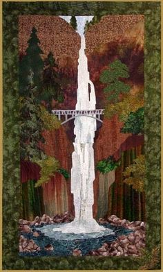This stunning quilt is designed by Helene Knott and features the Columbia River Gorge in Oregon. This natural marvel is known and admired throughout the world for its beauty and majesty. This artwork