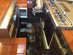 Black granite backsplash 4 my kitchen!!! Lovely kitchen design using granite from www.Bedrosians.com