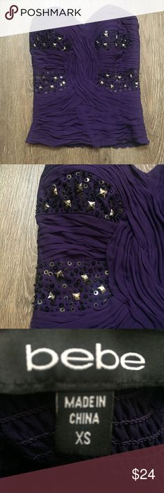 Bebe Purple Embellished Tube Top Size XS Pretty dark purple embellished tube top from Bebe. Size XS, the back has some stretch so could possible also fit a Small. bebe Tops