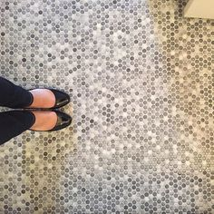 gray speckled penny tile floor is a cool neutral idea that fits many styles #bathroompictures