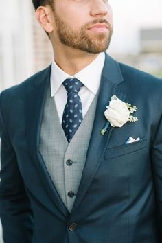 Charleston groom with navy suit and gray vest