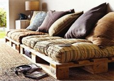 Upcycled Palette into a couch - love this for the deck for inexpensive seating!!