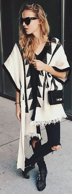 Best Of Instagram Fashion, March 2015: Marie vB is wearing an aztec print white poncho with black ripped jeans and ankle boots
