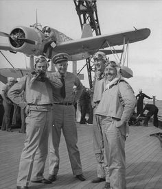 Aviators of battleship USS Maryland, an OS2U Kingfisher float plane in the background. Pearl harbor, 1941.