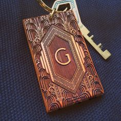 Bring some class into your everyday life when you use this Art Deco Engraved Key Chain to hold your keys or as an accessory to your bag.