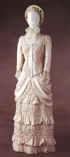 Wedding dress worn by Nastassja Kinski in 'Tess'. This is a two piece 1880s cream silk dress trimmed with lace.