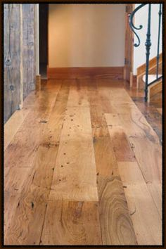 Love the idea of using reclaimed wide plank boards for flooring.....chestnut in this picture