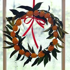 Break from tradition with this bright and cheerful Kumquat Leaf wreath! More ideas: http://www.bhg.com/christmas/crafts/simple-wreaths/