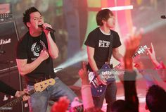 Singer Pierre Bouvier and guitarist Sebastien Lefebvre of Simple Plan perform on MTV's Total Request Live at the MTV Times Square Studios November 9, 2004 in New York City.