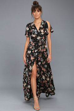 Spend your days wrapped up in the chic-as-can-be Divine Days Black Floral Print Wrap Maxi Dress! Breezy woven fabric drapes into a sultry surplice bodice, framed by fluttering short sleeves. Wrapping maxi skirt secures via internal ties and an adjustable waist tie.