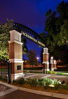 The new Jacksonville University Entrance Welcome Center creates a new formal entrance to the as well as a functional security feature. Gate Wall Design, Main Gate Design, Entrance Design, Entrance Signage, Modern Entrance, Entrance Gates, Main Entrance, Jacksonville University, Arch Gate