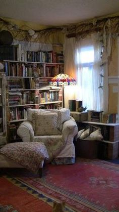 I must have a reading corner. It must have a comfortable chair, a Tiffany lamp, a footstool, a cozy quilt, and of course books. My favorite books!