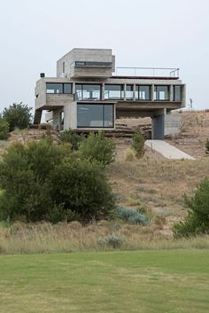 Golf House is a private residence located in La Costa Partido, Argentina. It was designed by Luciano Kruk Arquitectos in 2015.