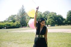 Birthday girl Alya Mooro in AQAQ black jumpsuit with gold belt and headband.