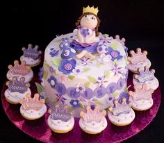 Pink and purple princess cake and cupcakes