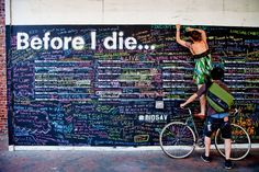 """What do you want to do before you die? Pick up a piece of chalk and leave your personal aspirations on the """"Before I Die"""" wall at SBMA outside the Family Resource Center today through October 23! This interactive art installation presented in collaboration with Hospice of Santa Barbara"""