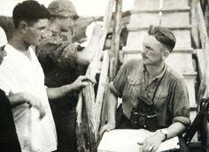 Original photo of Kurt Meyer receiving a report