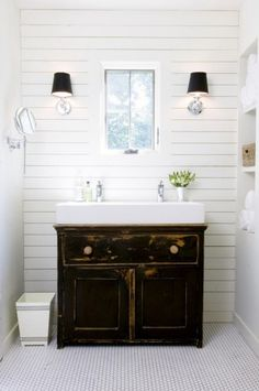 Modern farmhouse style with wood planked walls, trough sink, simple hex tile floors, and swing-arm vanity mirror. The trough sink worked perfectly on an antique cabinet previously used as a dining buffet. Simple Bathroom, Modern Bathroom, Master Bathroom, Small Bathrooms, White Bathroom, Chic Bathrooms, Downstairs Bathroom, Minimalist Bathroom, Compact Bathroom