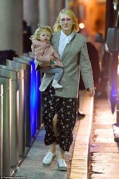 Her own style:Cate Blanchett looked laid back in a pair of pink rimmed sunglasses as she arrived at JFK Airport, New York City on Monday