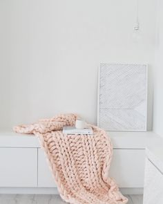 """Light pink throw blanket. Nordic scandi prints in this gorgeous white space. Available at www.closelyknit.com.au - Gorgeous and soft chunky knit made from 100% Australian 18 micron merino wool. Starting at $399.95 ship worldwide. 108 Likes, 17 Comments - Merino & Natural Fibres (@closely.knit) on Instagram: """"How delicious is this? All my loves - beautiful artwork, gorgeously scented candles and texture and…"""""""