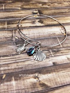 """This is my new favorite! I know someone who is getting one of these for Christmas!   """"Down by the Sea"""" Beachy Expandable Boho Bangle Charm Bracelet  Shell  by Simply Topaz"""
