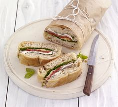 Pressed Picnic Sandwiches- A great recipe for kids to assemble - fully load a ciabatta loaf with favourites like prosciutto, artichokes, peppers, spinach and mozzarella : bbcgoodfood Picnic Snacks, Picnic Foods, Picnic Ideas, Posh Picnic Food, Picnic Parties, Bbc Good Food Recipes, Great Recipes, Cooking Recipes, Favorite Recipes