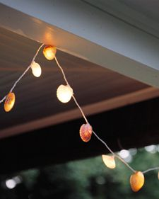 Glue seashells onto mini lights with colors to match your theme or decor. http://www.partylights.com/Mini-Lights