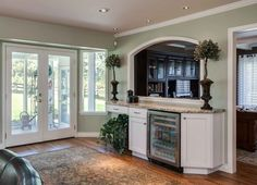 extra wet bar and beverage refrigerator in this open great room