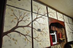 This is a picture of the kitchen cabinets in the process of being painted.  The branches have a couple of different colors of leaves.