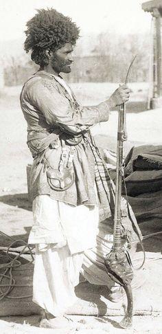 Afghan Warriors (1895), shown with jezail matchlock gun.