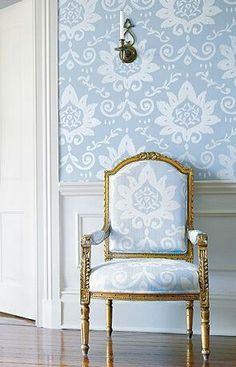 Love how the fabric was used on the chair and on the wall. The sky-blue looks so elegant with gold and white.