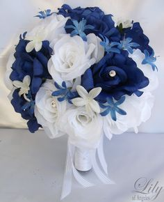 "17 Pieces Package Silk Flower Wedding Decoration Bridal Bouquet ROYAL BLUE WHITE ""Lily Of Angeles"". $199.99, via Etsy."