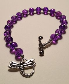 Spring 2013 Collection: Purple Dragonfly Bracelet made with purple glass beads, silver spacer beads and a silver dragonfly toggle clasp. $24.99