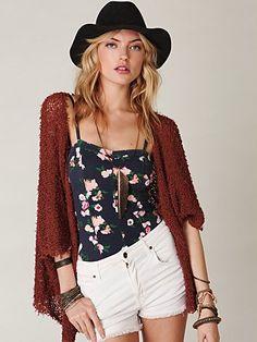 white short, floral shirt, maroon cardigan