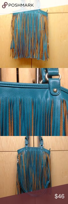 Flirty, Fun Fringe Purse This fringe purse is a MUST! This faux leather fringe bag can be worn many different ways! Notice the adjustable strap! It can even be worn as a crossbody bag! Great condition! Only used once! Bags