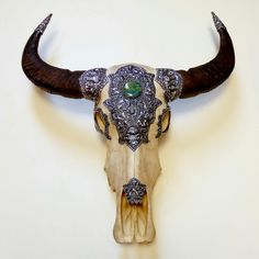Outrageous Third Eye Water Buffalo Skull encrusted with hand wrought sterling silver and large round turquoise cabochon.  All chasing and repousse done by master Balinese artist. WOW!