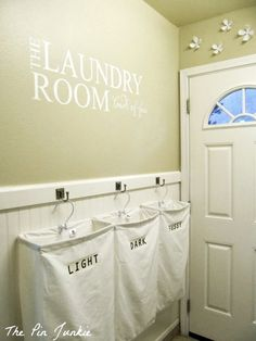 Laundry Room Makeover with Personalized Hanging Laundry Bags, The Pin Junkie featured on Remodelaholic.com #laundry
