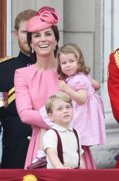 Catherine, Duchess of Cambridge, Princess Charlotte of Cambridge and Prince George of Cambridge look out from the balcony of Buckingham Palace during the Trooping the Colour parade on June 2017 in London.UNCLE HARRY BEHIND KATE.